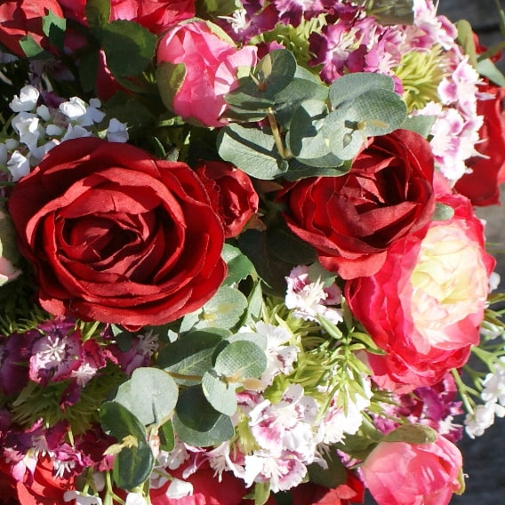 Pink and red silk flowers