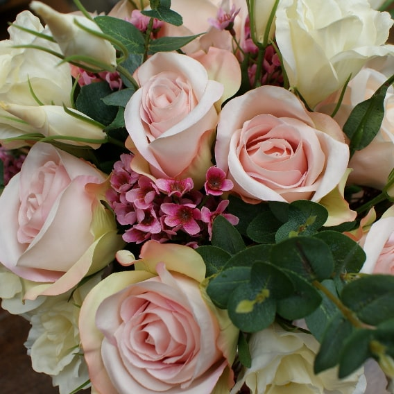 Silk roses and wax flowers