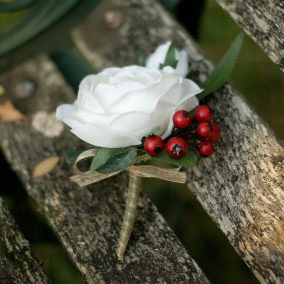 White rose buttonhole with berries