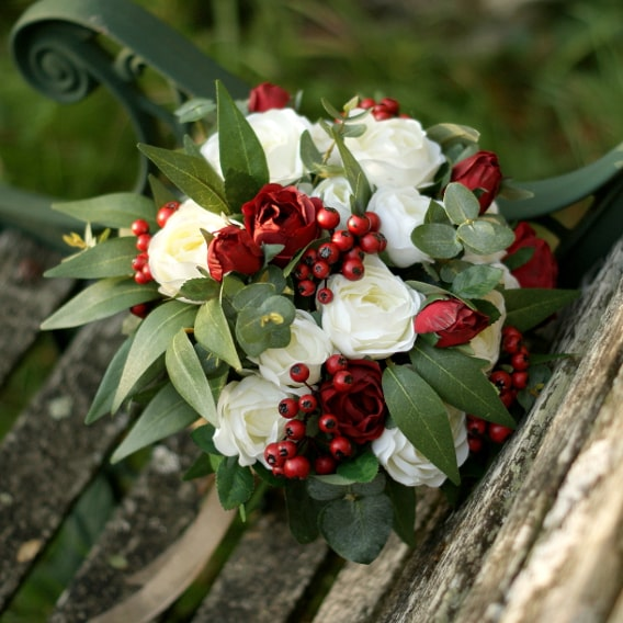 Winter silk bouquet of white roses and berries