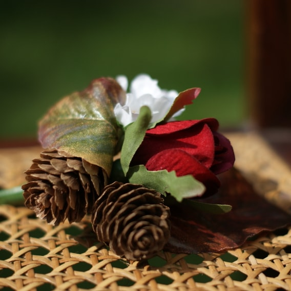 Artificial rose buttonhole with cones