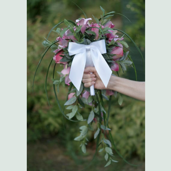 White ribbon bow on bouquet handle