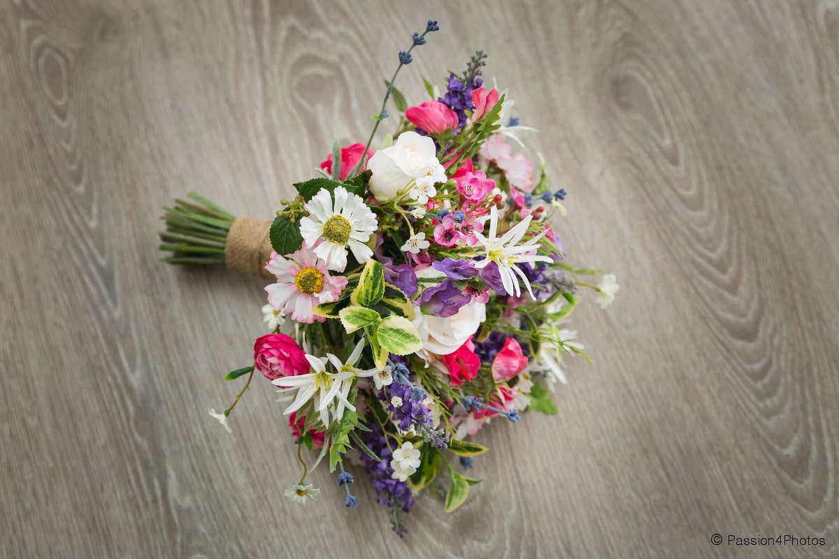 Silk bouquet on wooden floor