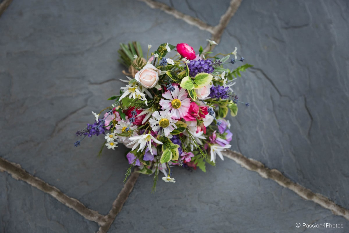 Wedding bouquet on stone floor