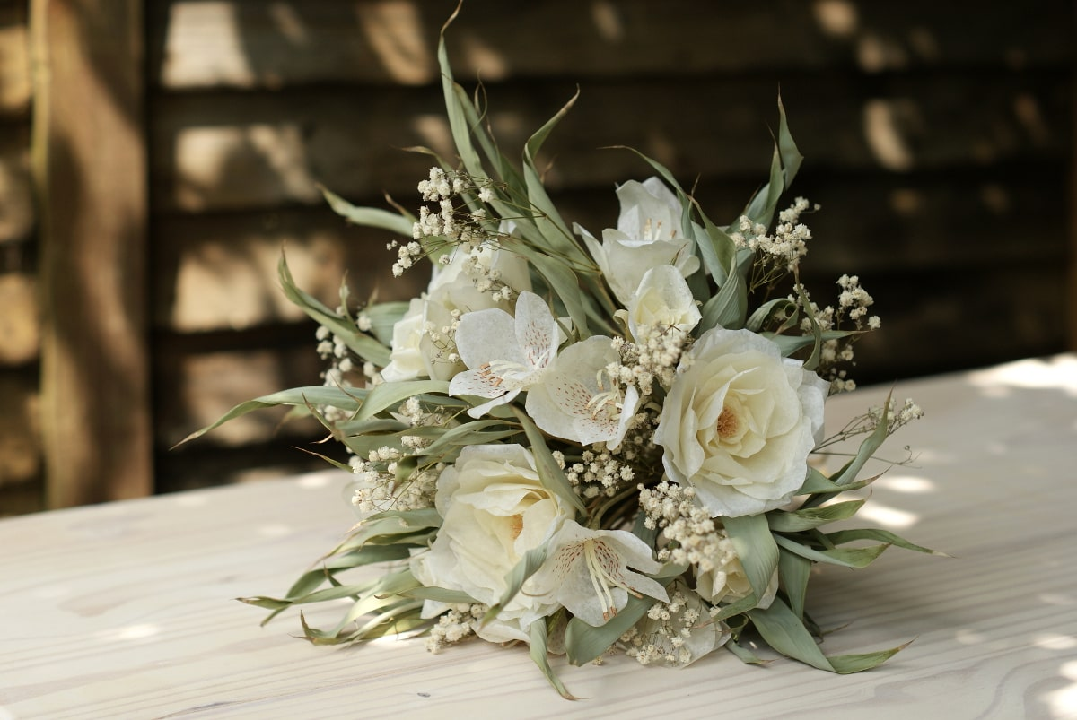 white paper rose and dried bamboo leaf bouquet