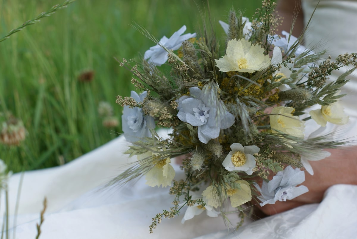 paper flowers and dried grasses bouquet