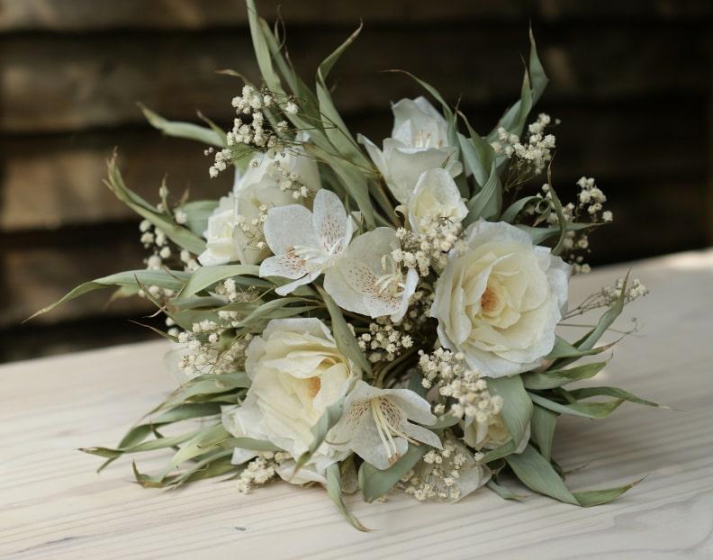 white paper flower wedding bouquet